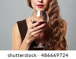 beautiful woman with glass red... | Shutterstock . vector #486669724