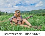 girl playing guitar on a meadow ... | Shutterstock . vector #486678394