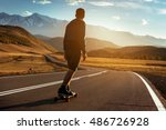 man rides at straight road on... | Shutterstock . vector #486726928