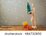 Wooden Artistic Figure Holding...