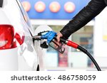hand refilling the car with fuel | Shutterstock . vector #486758059