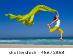 beautiful young woman jumping... | Shutterstock . vector #48675868