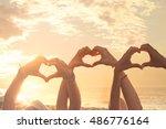 three hands of a heart shaped... | Shutterstock . vector #486776164