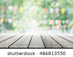 empty wooden table with party... | Shutterstock . vector #486813550