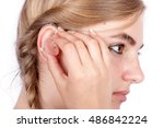 Teen Girl Inserting A Hearing...