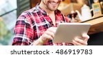 young man using browsing tablet ... | Shutterstock . vector #486919783