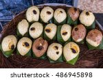 Small photo of Quimbolitos, cornmeal cakes and wheat; wrapped in a achira leaf (Canna indica) steamed