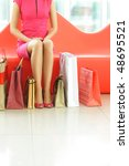 woman with bags in shopping mall | Shutterstock . vector #48695521