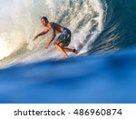 picture of surfing a wave... | Shutterstock . vector #486960874