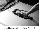 Small photo of Cleaning the car,car care concept. black and white tone filter