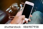 man's hands holding smart phone ... | Shutterstock . vector #486987958