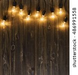 light bulbs on dark wooden... | Shutterstock . vector #486991558