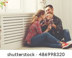 happy family mother and father... | Shutterstock . vector #486998320