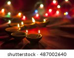 clay diya lamps lit during... | Shutterstock . vector #487002640