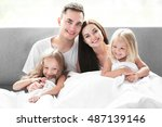 happy parents with daughters... | Shutterstock . vector #487139146