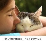 Stock photo teen girl hug cat close up monochrome portrait on the summer garden background 487149478