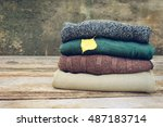 pile of colorful warm clothes... | Shutterstock . vector #487183714