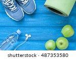 flat lay sport shoes  bottle of ... | Shutterstock . vector #487353580