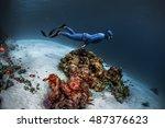freediver gliding underwater... | Shutterstock . vector #487376623