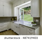 kitchen with large window  | Shutterstock . vector #487419403
