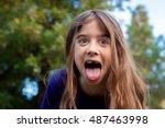A Young Girl Makes A Funny Fac...