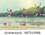 young boys jumping into the... | Shutterstock . vector #487515988