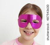 little girl and mask | Shutterstock . vector #487543630