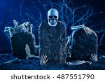 Small photo of skeleton are scatter on the tombstone in the night time graveyard