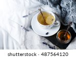 Stock photo tray with honey and a cup of hot tea in the bed lazy morning warm winter mood 487564120