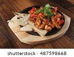 fajitas with chicken and bell... | Shutterstock . vector #487598668