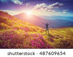 men welcome sunrise with raised ... | Shutterstock . vector #487609654