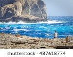 Tourist Observe The Rough Seas...