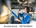 male mechanic with flashlight... | Shutterstock . vector #487663864