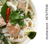 Small photo of Vietnamese traditional noodle pho soup made of broth, herbs, meat and rice noodles. It is a popular street food in Vietnam being served at any time of the day, starting from breakfast. Overhead shot