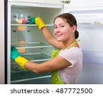 young smiling woman in apron... | Shutterstock . vector #487772500