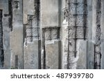 Damaged concrete walls with exposed steel reinforcements inside. - stock photo