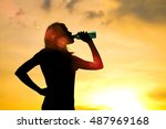 silhouette of woman is drinking ... | Shutterstock . vector #487969168