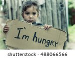 Little Girl Holding A Sheet Of...