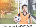 little boy holding football... | Shutterstock . vector #488096428