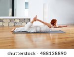 yoga exercise in wooden floor... | Shutterstock . vector #488138890