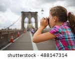 Girl Takes Pictures On The...