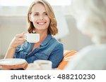 joyful woman drinking tea with... | Shutterstock . vector #488210230
