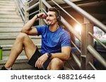 handsome male jogger listening... | Shutterstock . vector #488216464
