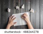 hands wresting the sheet of... | Shutterstock . vector #488264278