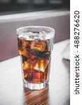 coke splashing from glass on... | Shutterstock . vector #488276620