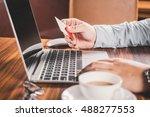 businessman hands on a rustic... | Shutterstock . vector #488277553