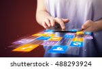 hand holding tablet device with ... | Shutterstock . vector #488293924