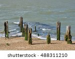 wooden posts by sea | Shutterstock . vector #488311210