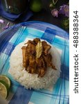 Small photo of Philippine Chicken Adobo Flakes Recipe with White Rice on a Blue Plate