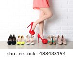 woman choosing shoes on high... | Shutterstock . vector #488438194